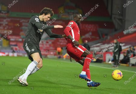 Sadio Mane (R) of Liverpool in action against Victor Lindelof (L) of Manchester United during the English Premier League soccer match between Liverpool FC and Manchester United in Liverpool, Britain, 17 January 2021.