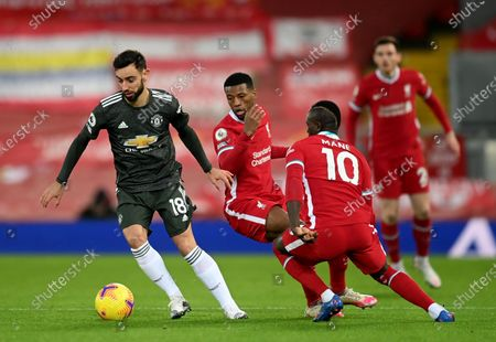 Sadio Mane (R) of Liverpool in action against Bruno Fernandes (L) of Manchester United during the English Premier League soccer match between Liverpool FC and Manchester United in Liverpool, Britain, 17 January 2021.