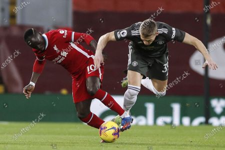 Sadio Mane (L) of Liverpool in action against Scott McTominay (R) of Manchester United during the English Premier League soccer match between Liverpool FC and Manchester United in Liverpool, Britain, 17 January 2021.