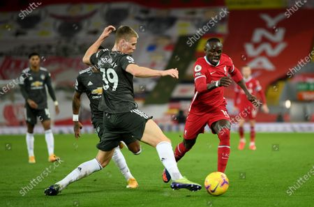 Sadio Mane (R) of Liverpool in action against Scott McTominay (L) of Manchester United during the English Premier League soccer match between Liverpool FC and Manchester United in Liverpool, Britain, 17 January 2021.