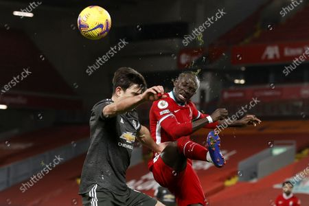 Sadio Mane (R) of Liverpool in action against Harry Maguire (L) of Manchester United during the English Premier League soccer match between Liverpool FC and Manchester United in Liverpool, Britain, 17 January 2021.