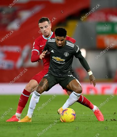 Jordan Henderson (L) of Liverpool in action against Marcus Rashford (front) of Manchester United during the English Premier League soccer match between Liverpool FC and Manchester United in Liverpool, Britain, 17 January 2021.