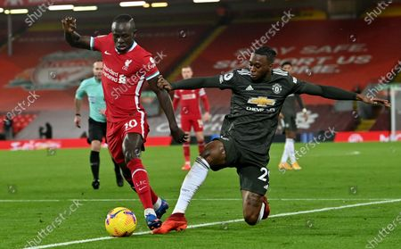 Sadio Mane (L) of Liverpool in action against Aaron Wan-Bissaka (R) of Manchester United during the English Premier League soccer match between Liverpool FC and Manchester United in Liverpool, Britain, 17 January 2021.