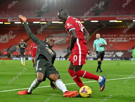 Sadio Mane (R) of Liverpool in action against Aaron Wan-Bissaka (L) of Manchester United during the English Premier League soccer match between Liverpool FC and Manchester United in Liverpool, Britain, 17 January 2021.