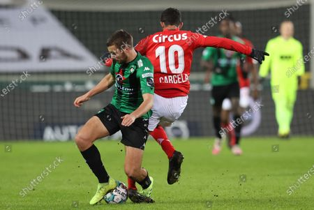 Cercle's Charles Vanhoutte and Standard's Mehdi Carcela fight for the ball during a soccer match between Cercle Brugge and Standard de Liege, Sunday 17 January 2021 in Brugge, on day 20 of the 'Jupiler Pro League' first division of the Belgian championship.