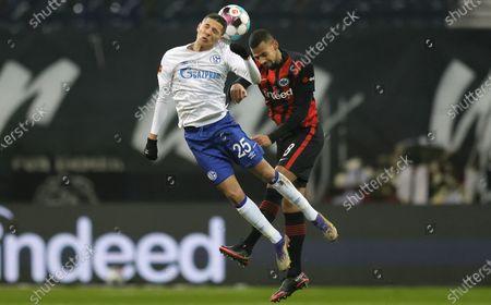 Schalke's Amine Harit (L) in action against Frankfurt's Djibril Sow (R) during the German Bundesliga soccer match between Eintracht Frankfurt and FC Schalke 04 in Frankfurt, Germany, 17 January 2021.