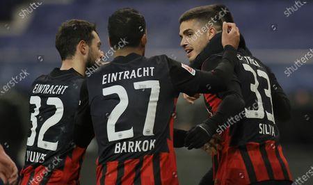 Frankfurt's Andre Silva (R) celebrates with teammates after scoring the 1-0 lead during the German Bundesliga soccer match between Eintracht Frankfurt and FC Schalke 04 in Frankfurt, Germany, 17 January 2021.