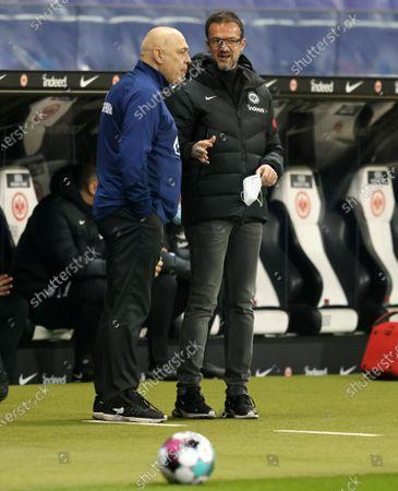Fredi Bobic (R), sports director of Eintracht Frankfurt, talks to Schalke's head coach Christian Gross (L) before the German Bundesliga soccer match between Eintracht Frankfurt and FC Schalke 04 in Frankfurt, Germany, 17 January 2021.