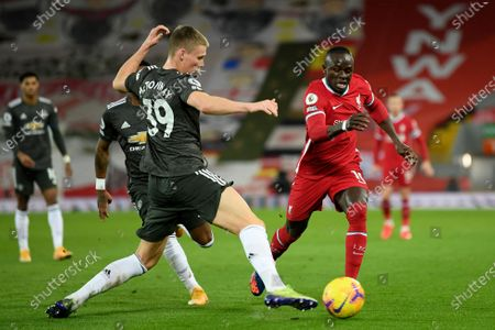 Stock Image of Manchester United's Scott McTominay tries to stop Liverpool's Sadio Mane, right, during the English Premier League soccer match between Liverpool and Manchester United at Anfield Stadium, Liverpool, England