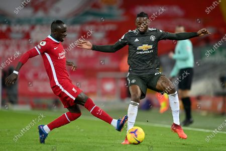 Liverpool's Sadio Mane vies for the ball with Manchester United's Aaron Wan-Bissaka, right, during the English Premier League soccer match between Liverpool and Manchester United at Anfield Stadium, Liverpool, England