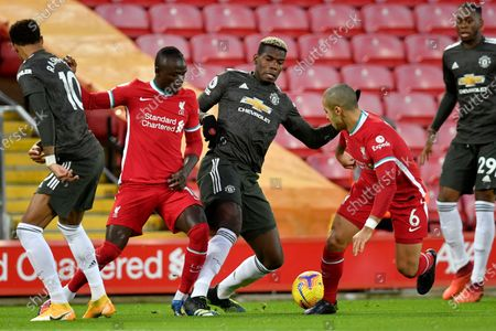 Stock Photo of Manchester United's Paul Pogba, center, vies for the ball with Liverpool's Sadio Mane and Thiago, 2nd right, during the English Premier League soccer match between Liverpool and Manchester United at Anfield Stadium, Liverpool, England