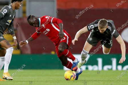Liverpool's Sadio Mane vies for the ball with Manchester United's Scott McTominay, right, during the English Premier League soccer match between Liverpool and Manchester United at Anfield Stadium, Liverpool, England