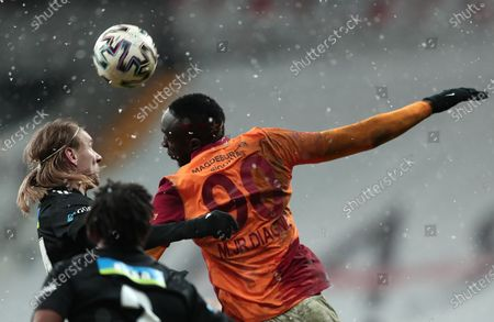 Domagoj Vida (L) of Besiktas in action against Mbaye Diagne (R) of Galatasaray during the Turkish Super League soccer derby match between Besiktas and Galatasaray in Istanbul, Turkey, 17 January 2021.