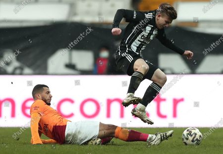 Ridvan Yilmaz (top) of Besiktas in action against Younes Belhanda (down) of Galatasaray during the Turkish Super League soccer derby match between Besiktas and Galatasaray in Istanbul, Turkey, 17 January 2021.