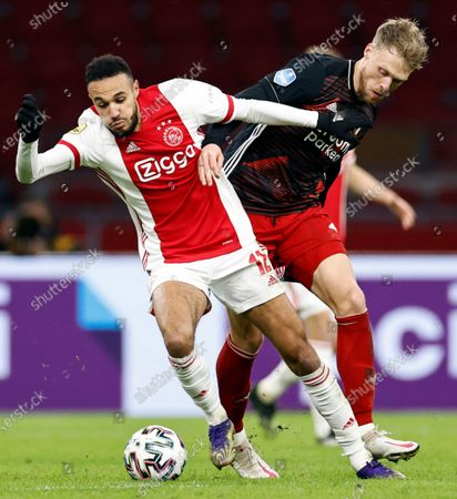 Stock Image of Noussair Mazraoui (L) of Ajax and Nicolai Jorgensen or Feyenoord in action during the Dutch Eredivisie match between Ajax Amsterdam and Feyenoord Rotterdam at the Johan Cruijff Arena in Amsterdam, The Netherlands, 17 January 2021.