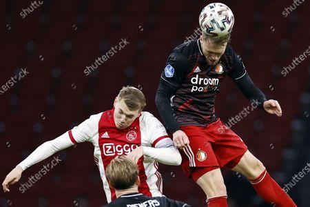 (L-R) -  Perr Schuurs of Ajax, Nicolai Jorgensen of Feyenoord in action during the Dutch Eredivisie match between Ajax Amsterdam and Feyenoord Rotterdam at the Johan Cruijff Arena in Amsterdam, The Netherlands, 17 January 2021.