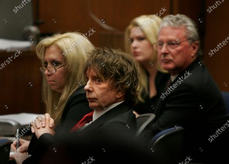 Stock Picture of Phil Spector, defense attorney Linda Kenney-Baden, left, a defense team support staff member, attorney Bradley Brunon, right, listen to a juror's answer to a question by Superior Court Judge Larry Paul Fidler after he announced Tuesday, Sept. 18, 2007, that he jury in the Phil Spector murder trial is unable to reach a verdict at the Clara Shortridge Foltz Criminal Justice Center in Los Angeles.The foreman said the jury was split 7-5, but wasn't allowed to say what the position of the majority was. The jury, whose deliberations are in the seventh day, sent a note this morning to the court announcing that it appeared to be hung, or unable to decide, on the issue of whether Spector killed actress Lana Clarkson on Feb. 3, 2003.
