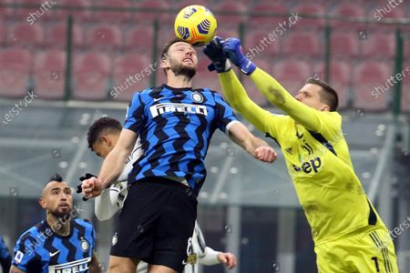 Stock Photo of Inter's Stefan de Vrij (L) challenges for the ball Juventus' goalkeeper Wojciech Szczesny during the Italian Serie A soccer match between FC Inter and Juventus FC at Giuseppe Meazza stadium in Milan, Italy, 17 January  2021.