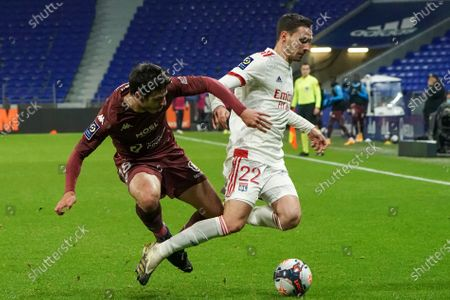 Metz's Fabien Centonze, left, and Lyon's Mattia De Sciglio fight for the ball during the French League One soccer match between Lyon and Metz, in Decines, near Lyon, central France