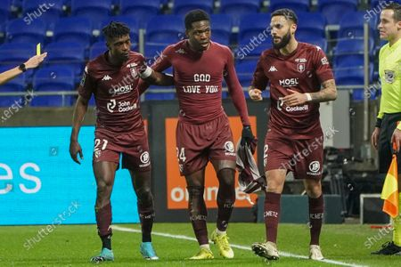 Stock Picture of Metz's Aaron Leya Iseka, center, celebrates with his teammates John Boye, left, and Dylan Bronn after he scored his side's first goal during the French League One soccer match between Lyon and Metz, in Decines, near Lyon, central France