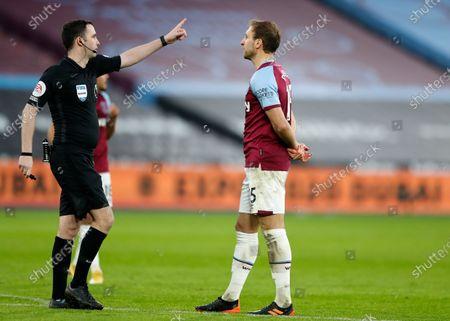 Referee Chris Kavanagh and Craig Dawson