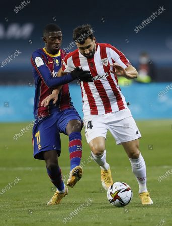 Stock Photo of FC Barcelona's Ousmane Dembele (L) in action against Athletic Bilbao's Mikel Balenziaga (R) during the Spanish Supercup final soccer match between FC Barcelona and Athletic Bilbao at Cartuja stadium, Seville, southern Spain, 17 January 2021.