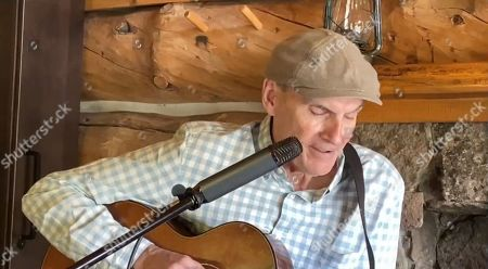 """Stock Image of James Taylor performs """"America the Beautiful""""."""