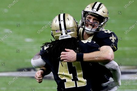 New Orleans Saints quarterback Drew Brees, right, celebrates with running back Alvin Kamara (41) during the second half of an NFL divisional round playoff football game against the Tampa Bay Buccaneers, in New Orleans