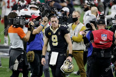 New Orleans Saints quarterback Drew Brees (9) leaves the field after an NFL divisional round playoff football game against the Tampa Bay Buccaneers, in New Orleans. The Buccaneers won 30-20