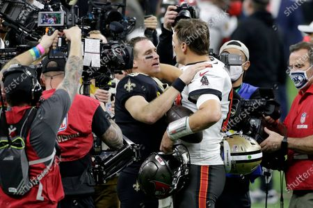 New Orleans Saints quarterback Drew Brees, center left, speaks with Tampa Bay Buccaneers quarterback Tom Brady after an NFL divisional round playoff football game, in New Orleans. The Buccaneers won 30-20