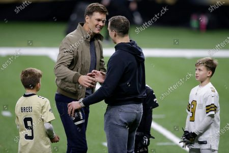 New Orleans Saints quarterback Drew Brees right, speaks with Tampa Bay Buccaneers quarterback Tom Brady as Bree's children look on after an NFL divisional round playoff football game between the New Orleans Saints and the Tampa Bay Buccaneers, in New Orleans. The Tampa Bay Buccaneers won 30-20