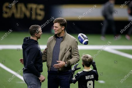 New Orleans Saints quarterback Drew Brees, left, speaks with Tampa Bay Buccaneers quarterback Tom Brady as Bree's children look on after an NFL divisional round playoff football game between the New Orleans Saints and the Tampa Bay Buccaneers, in New Orleans. The Tampa Bay Buccaneers won 30-20