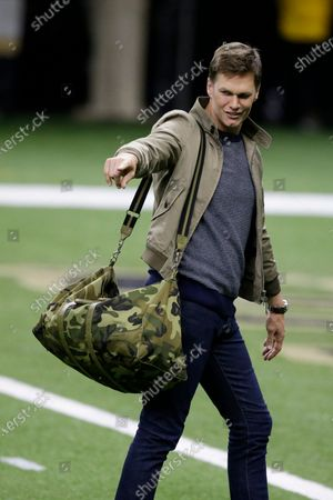 Tampa Bay Buccaneers quarterback Tom Brady leaves the field after speaking with New Orleans Saints quarterback Drew Brees after an NFL divisional round playoff football game, in New Orleans. The Tampa Bay Buccaneers won 30-20
