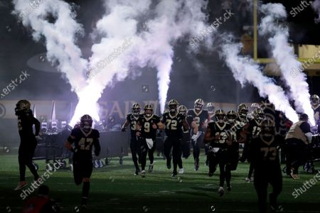New Orleans Saints quarterback Drew Brees (9) and teammates take the field before the first half of an NFL divisional round playoff football game between the New Orleans Saints and the Tampa Bay Buccaneers, in New Orleans