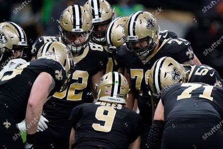 New Orleans Saints quarterback Drew Brees (9) calls a play in huddle during the first half of an NFL divisional round playoff football game against the Tampa Bay Buccaneers, in New Orleans