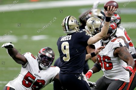 New Orleans Saints quarterback Drew Brees (9) works under pressure from Tampa Bay Buccaneers defensive tackle Rakeem Nunez-Roches (56) and nose tackle Steve McLendon (96) during the second half of an NFL divisional round playoff football game, in New Orleans