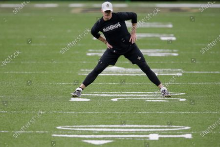 New Orleans Saints quarterback Drew Brees warms up before the first half of an NFL divisional round playoff football game against the Tampa Bay Buccaneers, in New Orleans