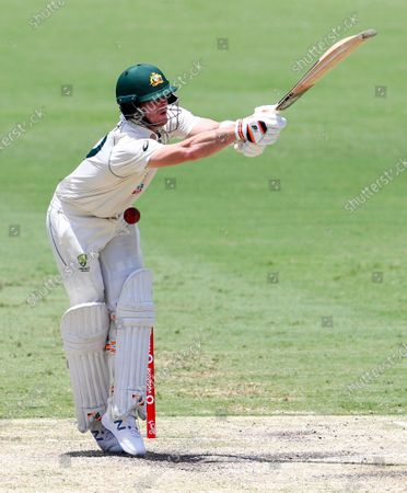 Australia's Steve Smith is hit while batting during play on day four of the fourth cricket test between India and Australia at the Gabba, Brisbane, Australia