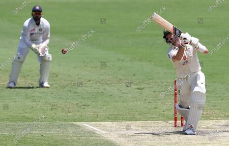 Australia's Steve Smith reacts as he bats during play on day four of the fourth cricket test between India and Australia at the Gabba, Brisbane, Australia