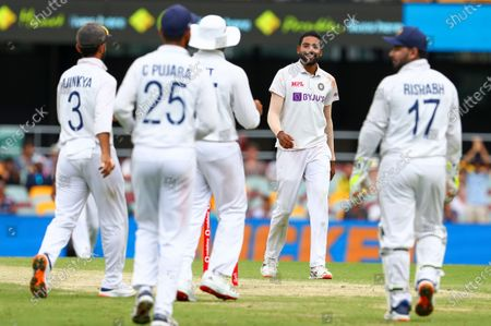 India's Mohammed Siraj reacts after dismissing Australia's Mitchell Starc during play on day four of the fourth cricket test between India and Australia at the Gabba, Brisbane, Australia
