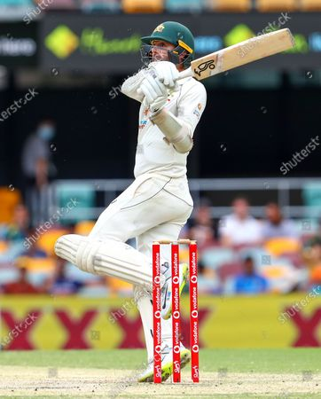 Australia's Nathan Lyon bats during play on day four of the fourth cricket test between India and Australia at the Gabba, Brisbane, Australia