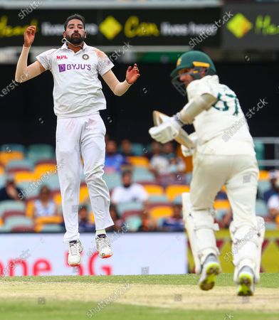 India's Mohammed Siraj, left, reacts after bowling to Australia's Nathan Lyon during play on day four of the fourth cricket test between India and Australia at the Gabba, Brisbane, Australia