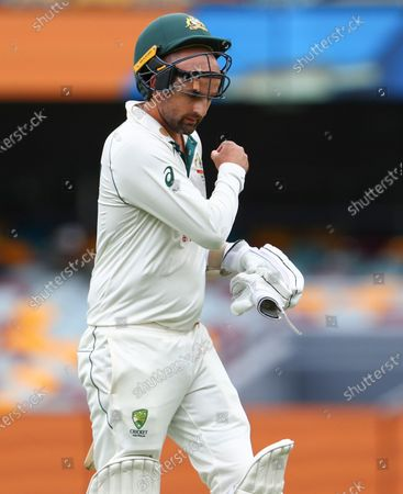 Australia's Nathan Lyon walks from the field after he was dismissed during play on day four of the fourth cricket test between India and Australia at the Gabba, Brisbane, Australia