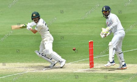 David Warner (L) of Australia in action during day four of the fourth Test Match between Australia and India at the Gabba in Brisbane, Australia, 18 January 2021.