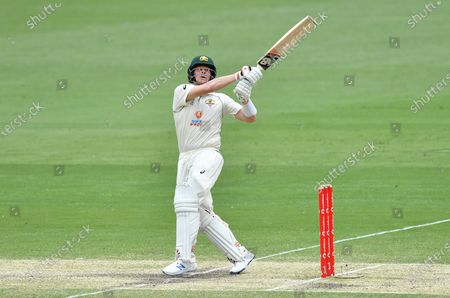 Steve Smith of Australia hits four runs during day four of the fourth Test Match between Australia and India at the Gabba in Brisbane, Australia, 18 January 2021.