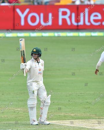 Steve Smith of Australia celebrates his half century during day four of the fourth Test Match between Australia and India at the Gabba in Brisbane, Australia, 18 January 2021.