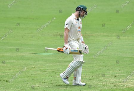 Steve Smith of Australia reacts after losing his wicket to Mohammed Siraj of India during day four of the fourth Test Match between Australia and India at the Gabba in Brisbane, Australia, 18 January 2021.