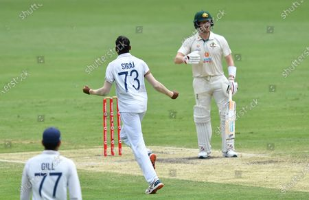 Steve Smith (R) of Australia reacts after losing his wicket to Mohammed Siraj (C) of India during day four of the fourth Test Match between Australia and India at the Gabba in Brisbane, Australia, 18 January 2021.