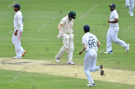 Stock Image of Steve Smith (C) of Australia reacts after losing his wicket to Mohammed Siraj of India during day four of the fourth Test Match between Australia and India at the Gabba in Brisbane, Australia, 18 January 2021.