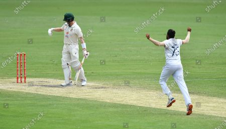 Stock Picture of Steve Smith (L) of Australia reacts after losing his wicket to Mohammed Siraj (R) of India during day four of the fourth Test Match between Australia and India at the Gabba in Brisbane, Australia, 18 January 2021.